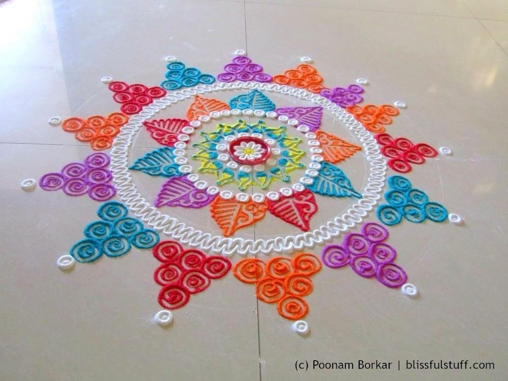Award winning rangoli designs for diwali with diya for Home made rangoli designs